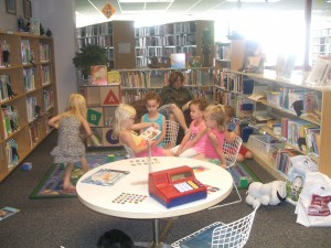 Children Reading to each other while their siblings are in SRP Class